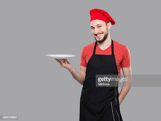 Chef und leere Teller