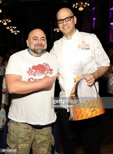 Chef and event host Duff Goldman poses for a photo with the winner chef Ron Paprocki during Food Network Cooking Channel New York City Wine Food...