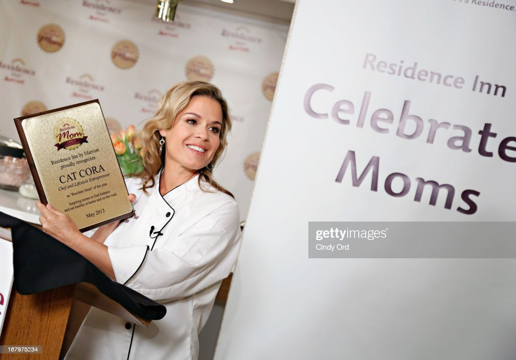 Chef and lifestyle entrepreneur <a gi-track='captionPersonalityLinkClicked' href=/galleries/search?phrase=Cat+Cora&family=editorial&specificpeople=4166787 ng-click='$event.stopPropagation()'>Cat Cora</a> receives the 2013 Resident Mom of the Year award at Residence Inn by Marriott on May 3, 2013 in New York City.