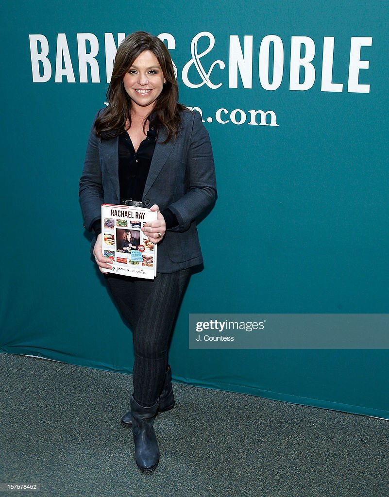 Chef and media personality Rachael Ray poses with a copy of her book 'My Year In Meals' at Barnes & Noble Union Square on December 4, 2012 in New York City.