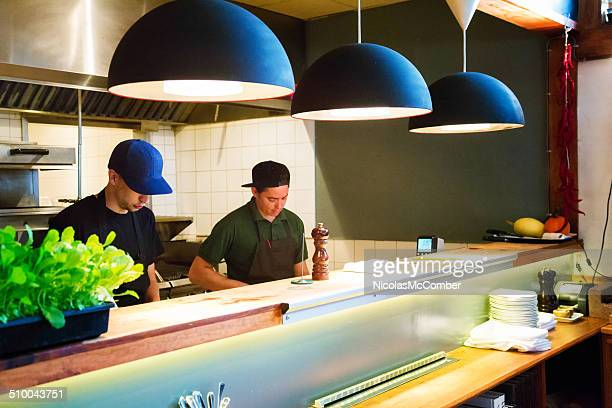 Chef and sous-chef working in restaurant