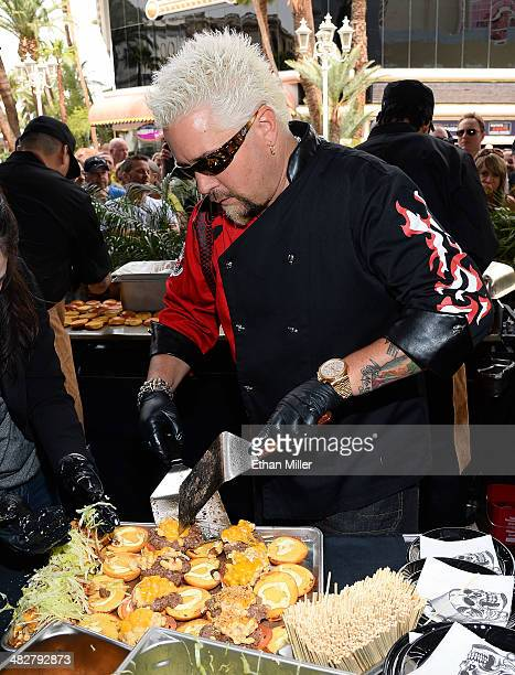 Chef and television personality Guy Fieri cooks hamburgers for guests during a welcome event for Guy Fieri's Vegas Kitchen Bar at The Quad Resort...