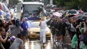 Chef and Torchbearer Jamie Oliver carries the Olympic Flame on the Torch Relay journey between Newport and Saffron Walden during Day 50 of the London...
