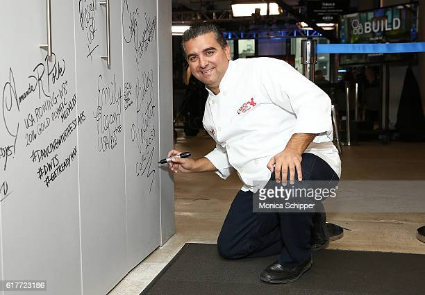 Chef and TV personality Buddy Valastro signs the wall at AOL HQ when he visits for The Build Series Presents Buddy Valastro Discussing His New...