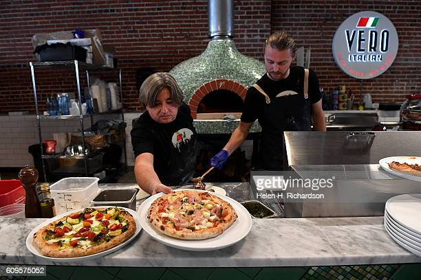 Chef Andrea Frizzi owner of Vero Italian left and Shane Burton general manager make pizzas at their new pizzeria at The Denver Central Market on...