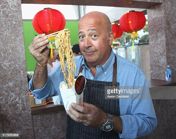 Chef Andrew Zimmern enjoys noodles the LUCKY CHOPSTICKS An Asian Night Market Hosted By Andrew Zimmern during 2016 Food Network Cooking Channel South...