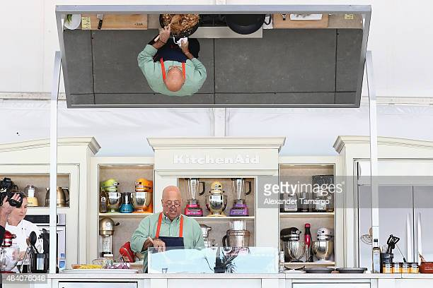 Chef Andrew Zimmern prepares food at the Whole Foods Market Grand Tasting Village Featuring MasterCard Grand Tasting Tents KitchenAid® Culinary...