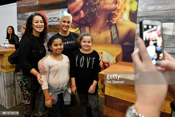 Chef Anne Burrell signs her cookbook Own Your Kitchen at the Food Network Cooking Channel New York City Wine Food Festival presented by CocaCola...
