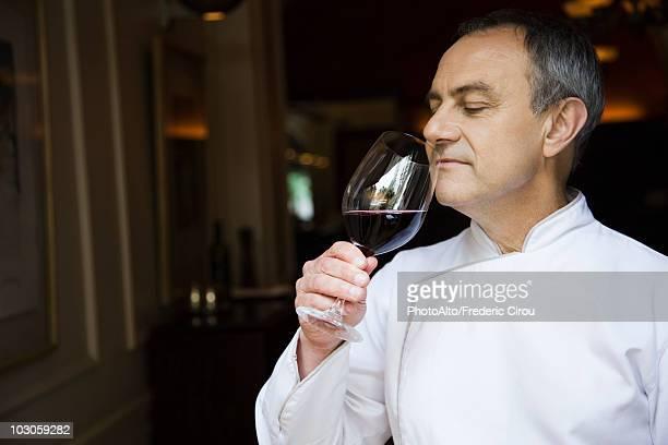Chef appreciating wine bouquet