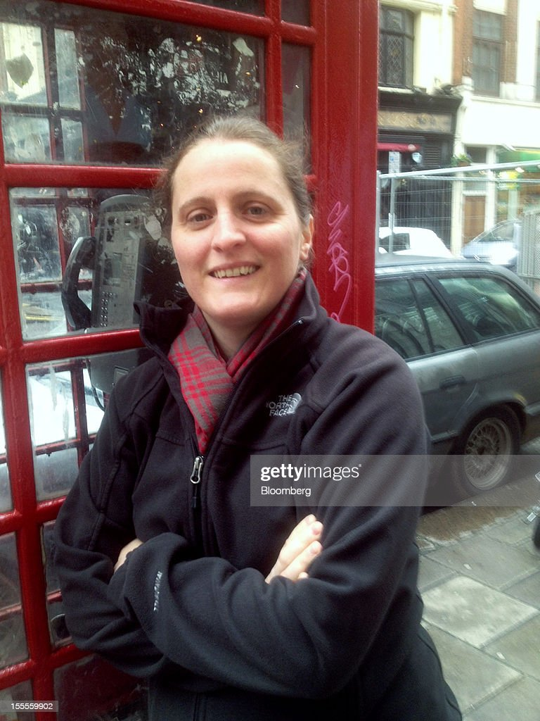 Chef April Bloomfield leans against a phone booth on Dean Street in the Soho neighborhood of London, U.K., on Friday, Oct. 26, 2012. The British-born chef has returned from New York to cook for the publication of her cookbook. Photographer: Richard Vines/Bloomberg via Getty Images