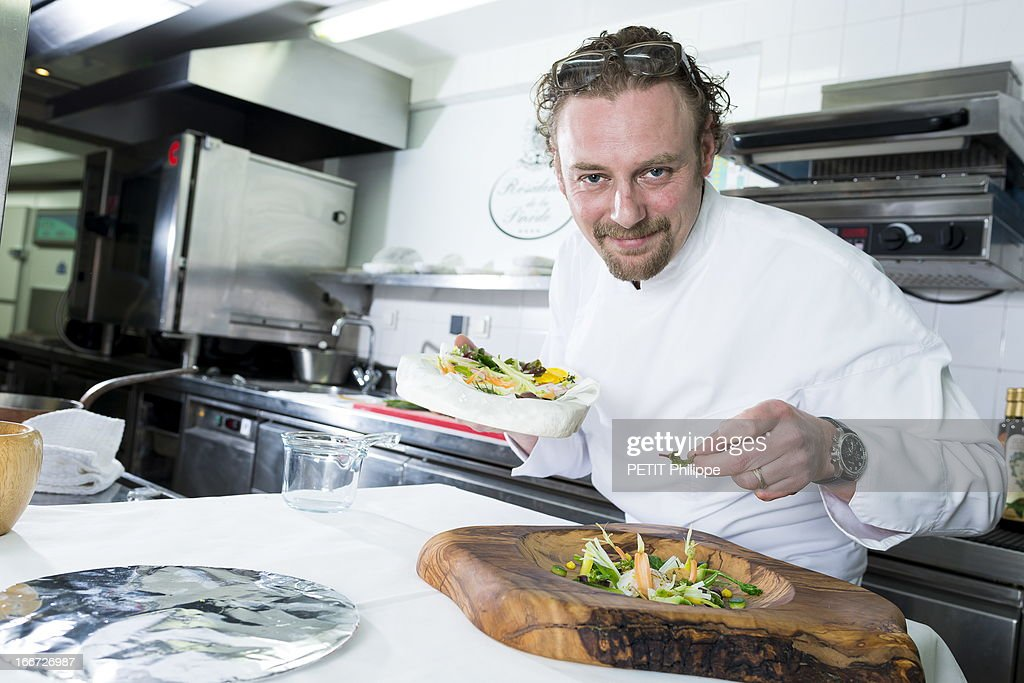 Chef Arnaud Donckele poses in the kitchen of his restaurant inside the hotel Residence de la Pinede on March 21, 2013 in Saint Tropez,France. Chef of the restaurant La Vague D'Or in the hotel La Residence de la Pinede who received his 3rd star from the famous gourmet guide Michelin.