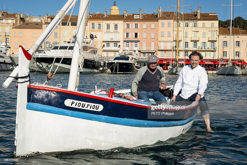 Chef Arnaud Donckele poses in the port of Saint Tropez on the former boat Piou Piou which belonged to Brigitte Bardot on March 21, 2013 in Saint Tropez,France. Chef of the restaurant La Vague D'Or in the hotel La Residence de la Pinede who received his 3rd star from the famous gourmet guide Michelin