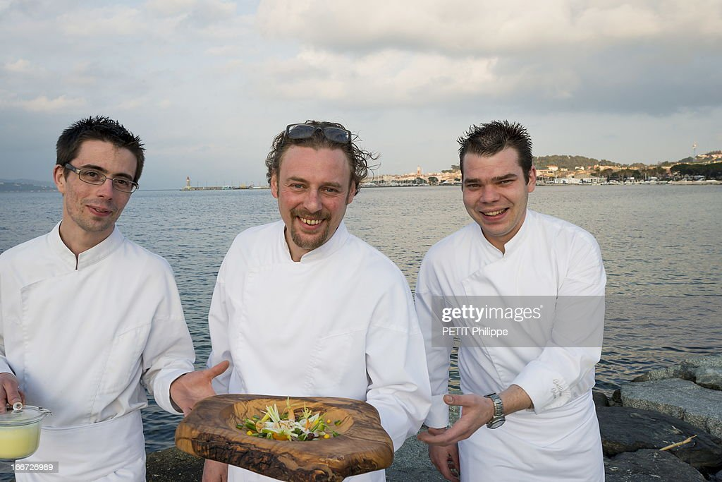 Chef Arnaud Donckele (C) poses with his second and the pasty chef Guillaume Gaudin (L) on March 21, 2013 in Saint Tropez,France. Chef of the restaurant La Vague D'Or in the hotel La Residence de la Pinede who received his 3rd star from the famous gourmet guide Michelin.