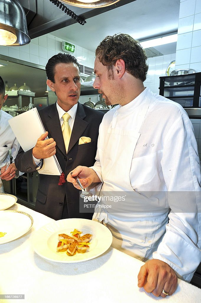 Chef Arnaud Donckele with Thierry Di Tullio the dinning room director in the kitchen of his restaurant inside the hotel Residence de la Pinede on March 21, 2013 in Saint Tropez,France. Chef of the restaurant La Vague D'Or in the hotel La Residence de la Pinede who received his 3rd star from the famous gourmet guide Michelin.