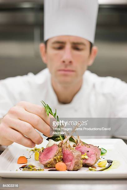 Chef arranging plate of food