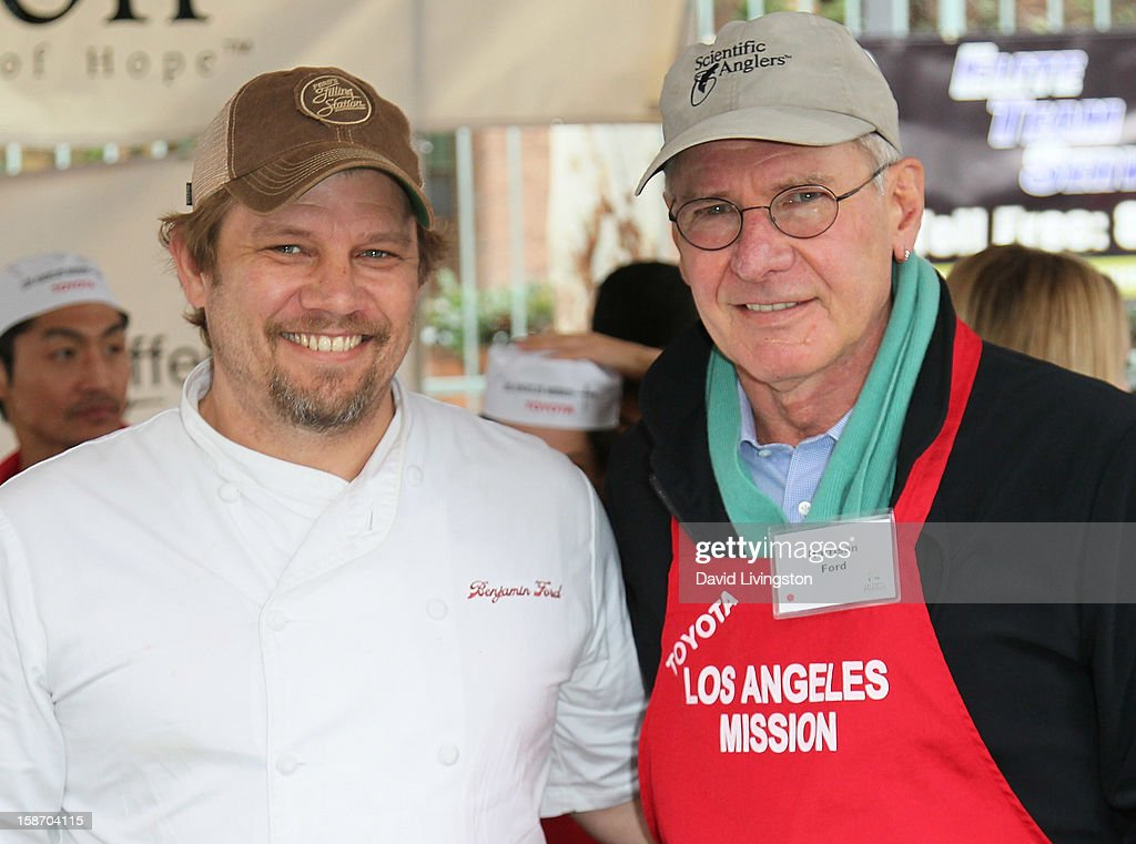 Chef Ben Ford (L) and father actor <a gi-track='captionPersonalityLinkClicked' href=/galleries/search?phrase=Harrison+Ford+-+Actor+-+Born+1942&family=editorial&specificpeople=11508906 ng-click='$event.stopPropagation()'>Harrison Ford</a> attend the Los Angeles Mission's Christmas Eve for the homeless at the Los Angeles Mission on December 24, 2012 in Los Angeles, California.