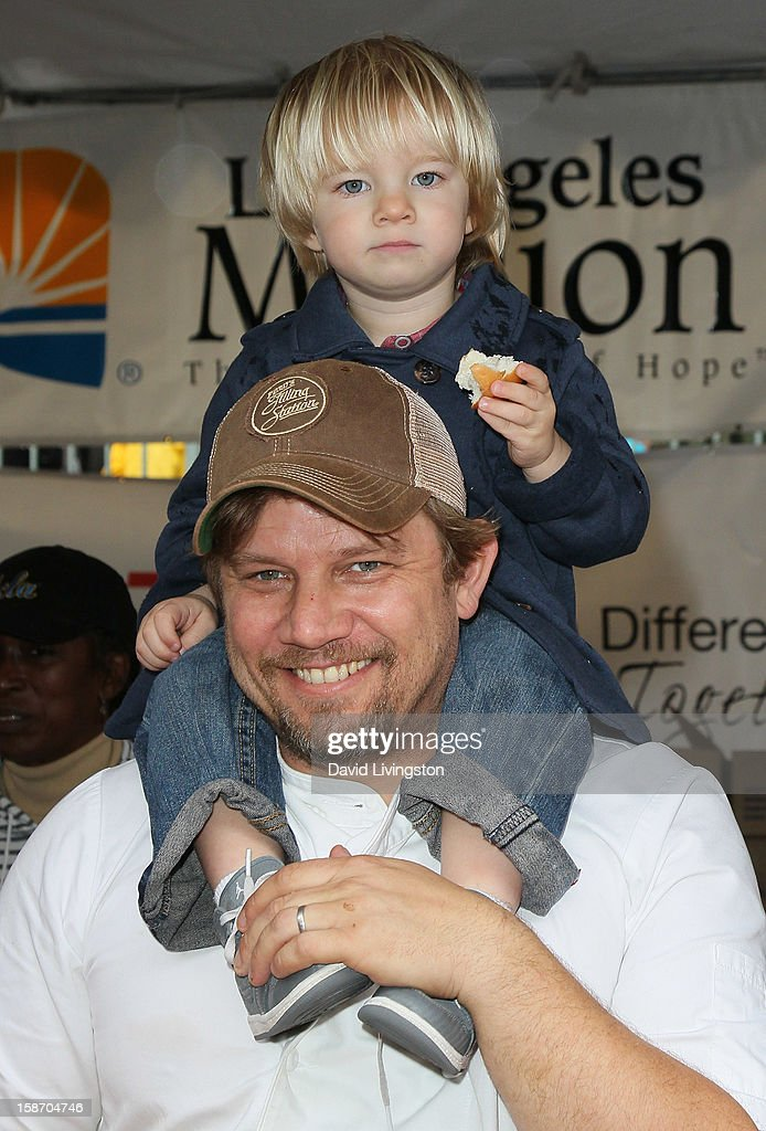 Chef Ben Ford and son attend the Los Angeles Mission's Christmas Eve for the homeless at the Los Angeles Mission on December 24, 2012 in Los Angeles, California.