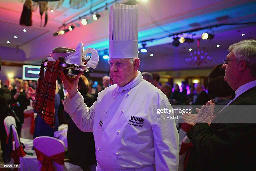 Chef Billy Campbell carries the haggis as it is piped into the Lord Provost Burns Supper, in the Thistle Hotel on on January 25, 2012 in Glasgow, Scotland. Burns suppers will be held today to commemorate the life of the poet Robert Burns, who was born on this day in 1759.