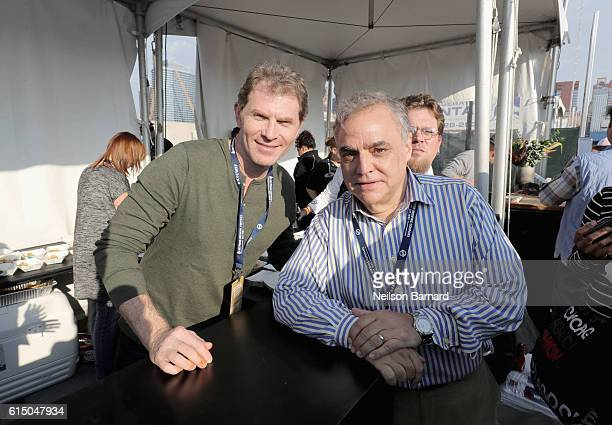 Chef Bobby Flay and New York City Wine Food Festival Founder Executive Director Lee Brian Schrager attend the CocaCola Backyard BBQ hosted by Bobby...