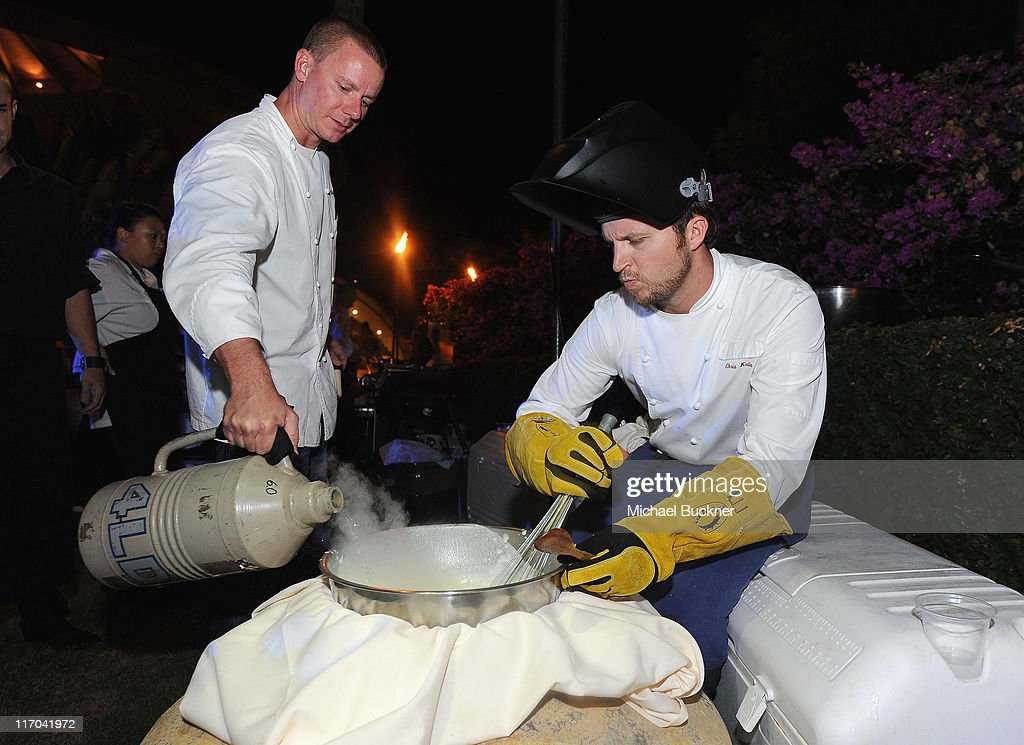 Chef Brian Etheredge (L) and Chef Chris Kulis prepare liquid nitrogen infused ice cream at the 2011 Maui Film Festival Closing Night Party at Capische on June 19, 2011 in Wailea, Hawaii.
