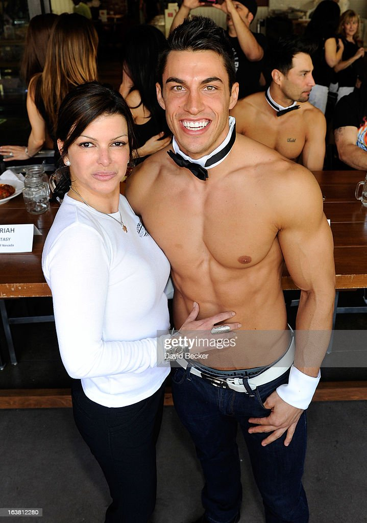 Chef Carla Pellegrino (L) and Chippendales dancer Jon Howes appear at the meatball eating contest at the Meatball Spot on March 16, 2013 in Las Vegas, Nevada.