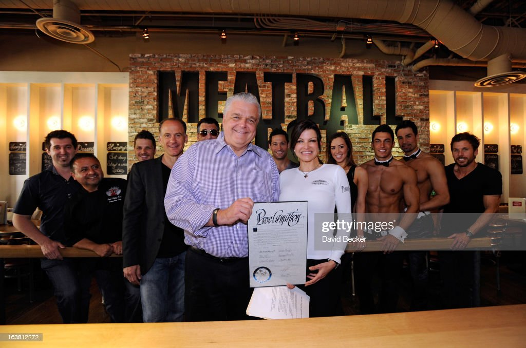 Chef Carla Pellegrino (R) receives a Meatball Day proclamation from Clark County Commissioner Steve Sisolak at the Meatball Spot on March 16, 2013 in Las Vegas, Nevada.