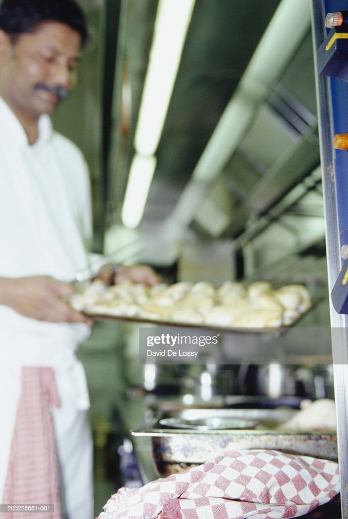 Chef carrying tray of food : Stock Photo