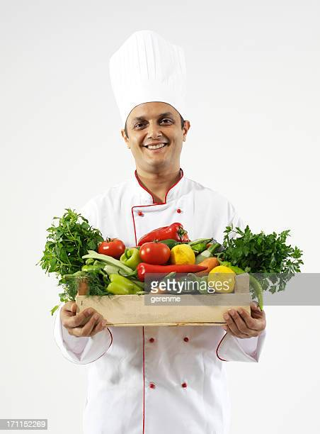 chef carrying vegetables
