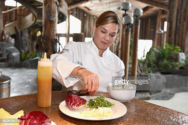 Chef Cat Cora prepares a salad during Lunch Celebrating Films Powered By Women Hosted By Glamour's Cindi Leive And Girlgaze's Amanda de Cadenet...