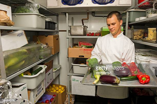 Chef checking his stockroom in preparation for the menu