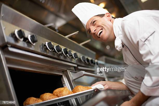 Chef Checking on Pastry in the Oven