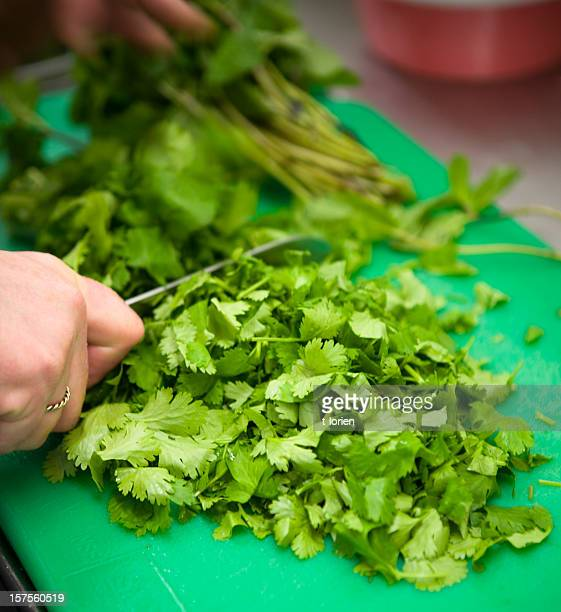 Chef chopping herbs.