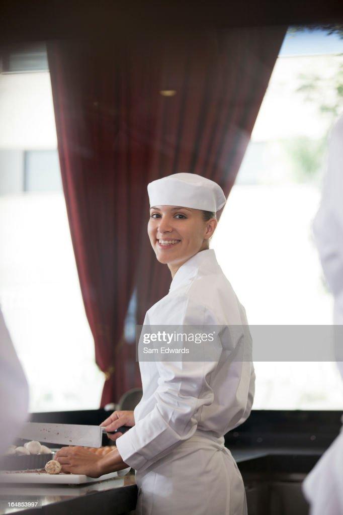 Chef chopping in restaurant kitchen : Stock Photo