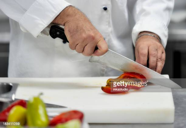 Chef chopping pepper