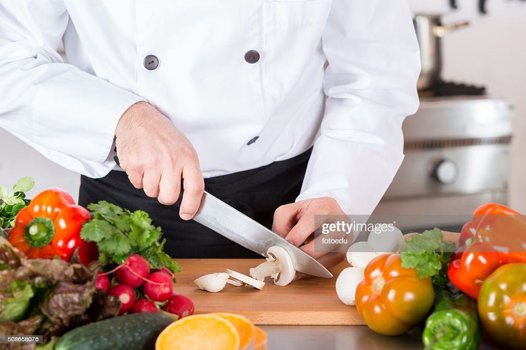 Chef chopping vegetables : Stock Photo