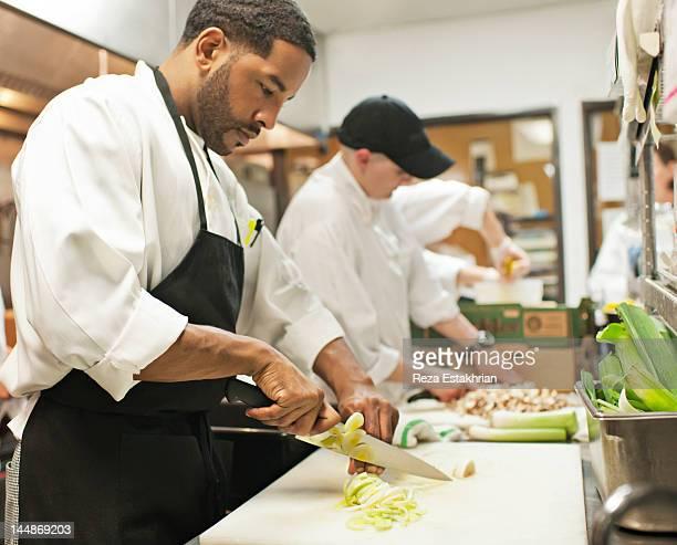Chef chops leeks