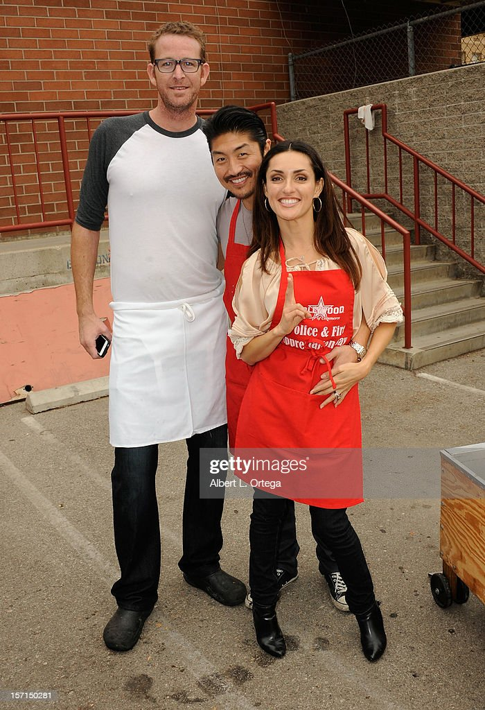 Chef C.J. Jacobson, actor Brian Tee and actress Mirelly Taylor participate in the Hollywood Chamber of Commerce's annual police and firefighters appreciation day at the Hollywood LAPD station on November 28, 2012 in Hollywood, California.