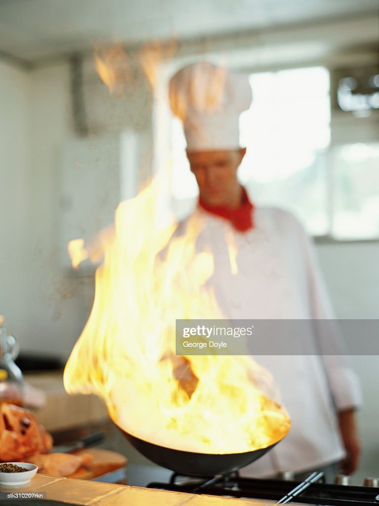 chef cooking food in the kitchen : Stock Photo