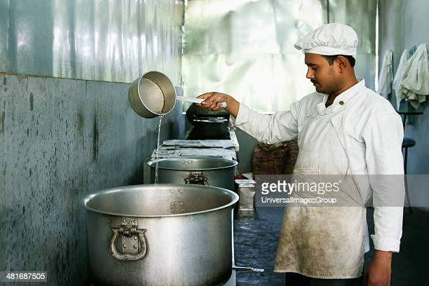 Chef cooking in a restaurant New Delhi India