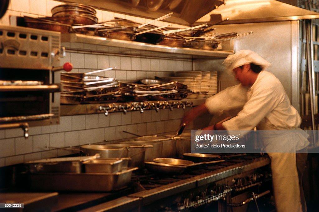 Chef cooking in restaurant kitchen : Stock Photo