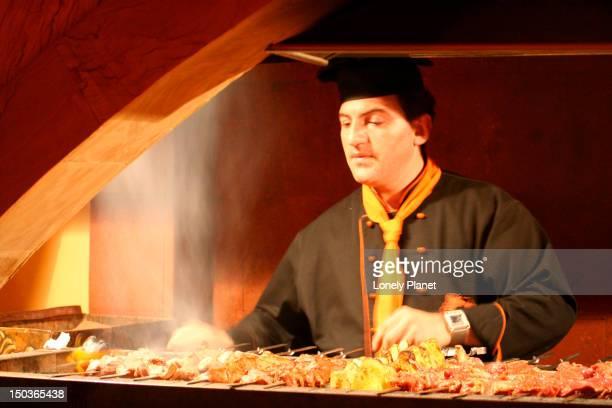 Chef cooking shashliks at Noah's Arc restaurant.