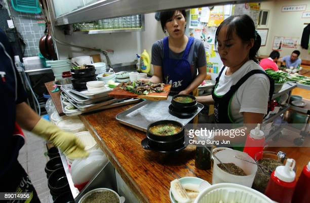A chef cooks dog meat soup in the kitchen at a restaurant on July 14 2009 in Seoul South Korea Dog meat is a traditional dish in Korea dating back to...