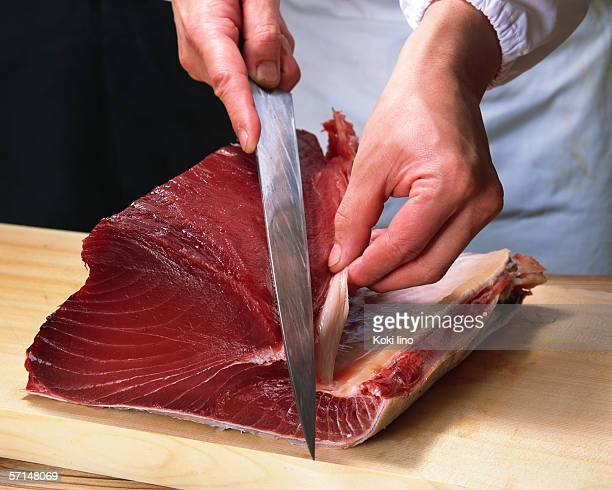 Chef cutting tuna