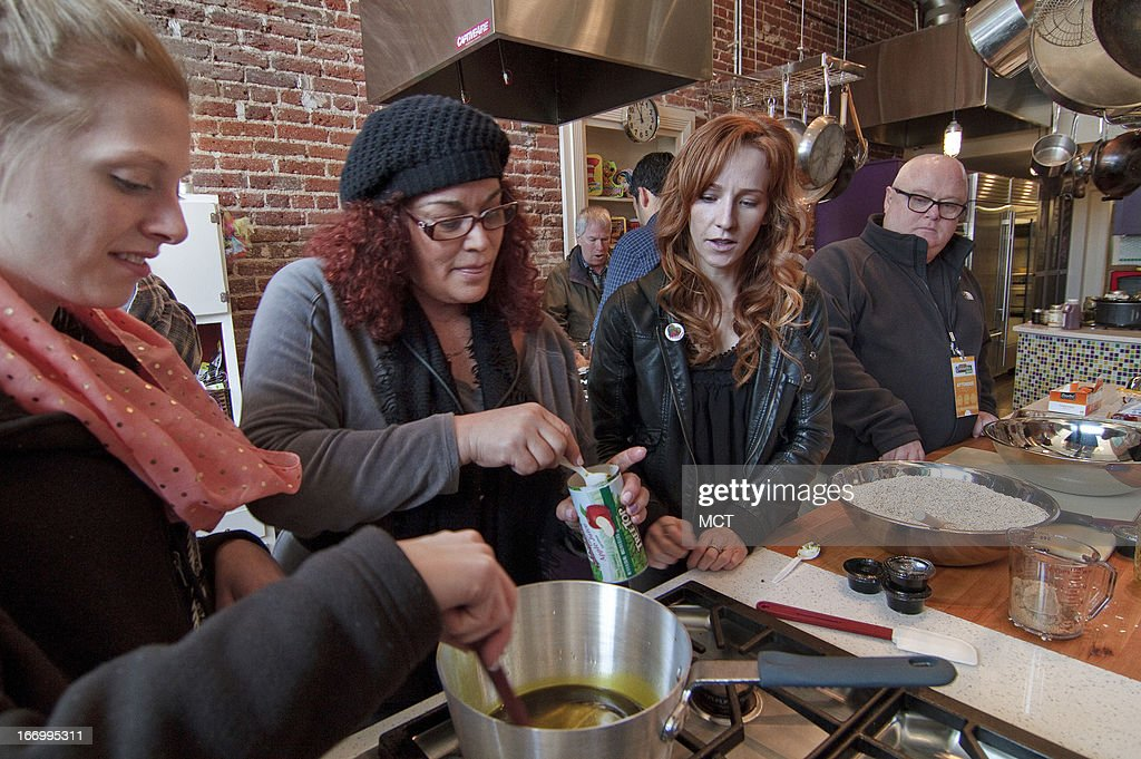 Chef Dani Fontaine, third from left, observes as participants Andrea, left, Nicole Hamrah and Brian Kelly prepare a cannabis-infused, gluten free trail mix during a cannabis cooking class in Denver, Colorado, on Thursday, April 18, 2013.