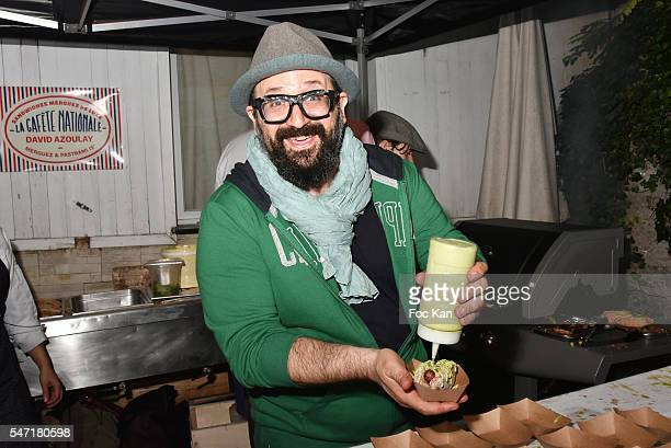 Chef David Azoulay from Merguez and Pastrami Restaurant proposes hot dogs with merguez during the 'La Cafete Nationale' by Le Fooding Auction Event...