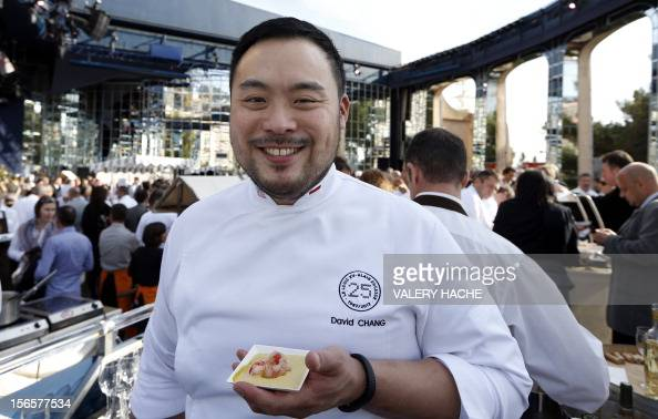 US chef David Chang poses during the festivities marking the 25th anniversary of French chef Alain Ducasse's restaurant 'Le Louis XV' on November 17...