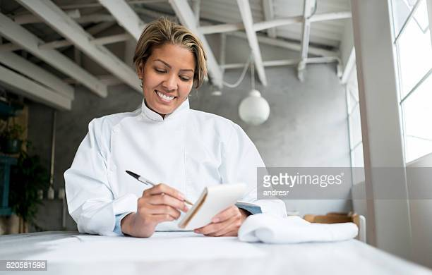 Chef doing the books at a restaurant