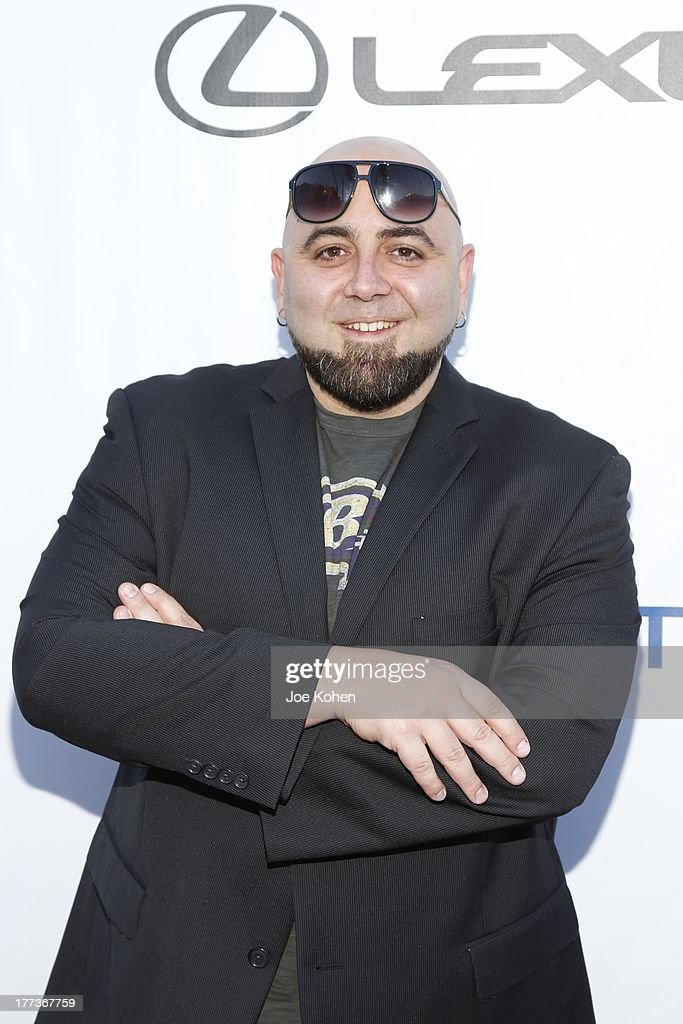 Chef <a gi-track='captionPersonalityLinkClicked' href=/galleries/search?phrase=Duff+Goldman&family=editorial&specificpeople=5366392 ng-click='$event.stopPropagation()'>Duff Goldman</a> attends the 2013 Los Angeles Food & Wine Festival 'Festa Italiana With Giada De Laurentiis' Opening Night Gala on August 22, 2013 in Los Angeles, California.