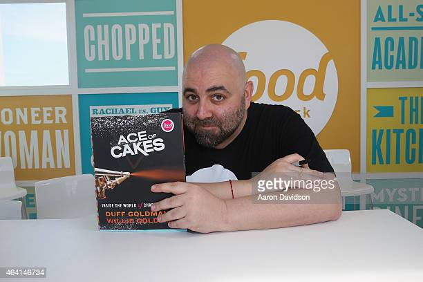 Chef Duff Goldman signs books at the KitchenAid Culinary Demonstrations during the 2015 Food Network Cooking Channel South Beach Wine Food Festival...