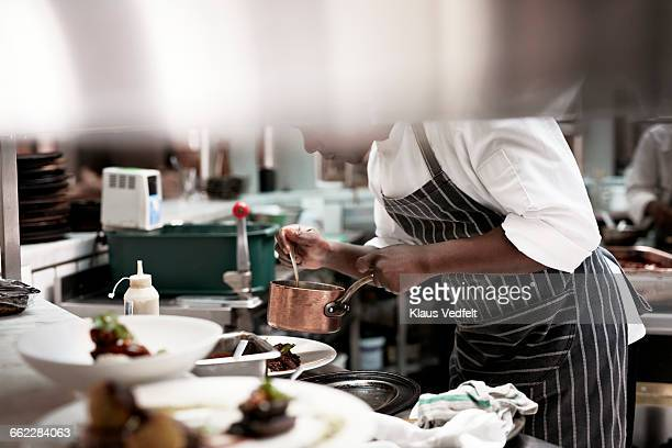Chef finishing dishes at restaurant